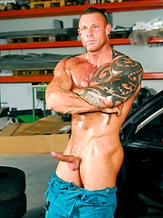 Muscled hunk Jack Dragon shows his tattoo